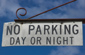 No parking day or night on hanging sign