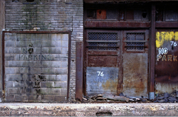 No parking on an old gray garage door