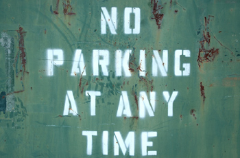 No parking on green metal surface
