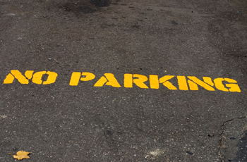No parking on the ground with yellow painted letters